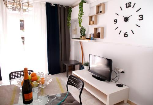 Una televisión o centro de entretenimiento en Costa del Silencio Apartment