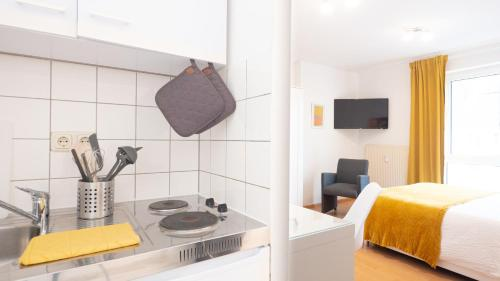 A kitchen or kitchenette at Relax Aachener Boardinghouse Phase 3