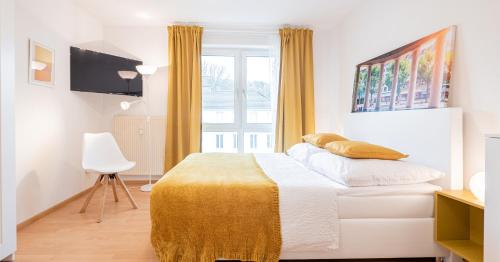 A bed or beds in a room at Relax Aachener Boardinghouse Phase 3