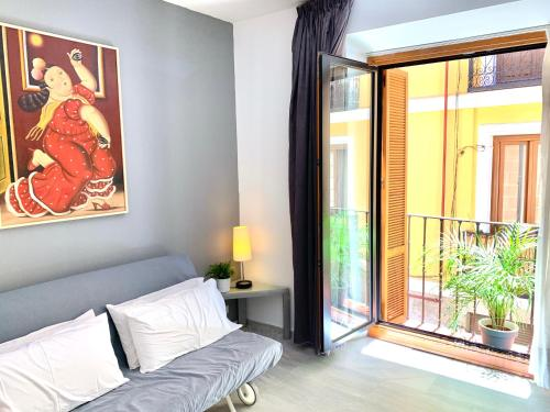 Zona de estar de Apartamentos Puerta Del Sol
