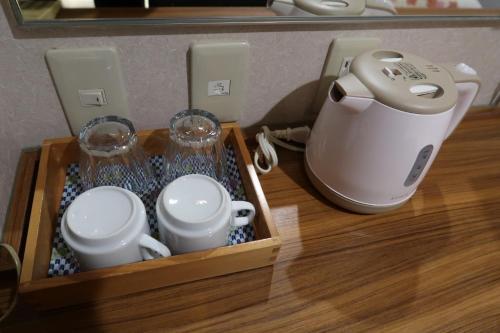 Coffee and tea-making facilities at Ueno Touganeya Hotel