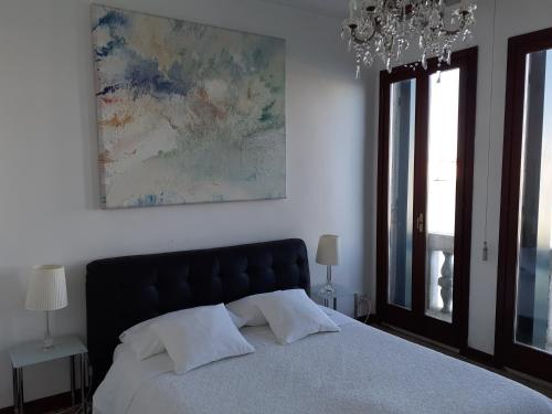 A bed or beds in a room at Apartment Il Giardino dell'Eden