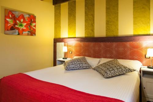 Cama o camas de una habitación en Alojamiento Bernabales