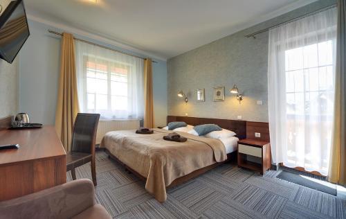 Łóżko lub łóżka w pokoju w obiekcie Willa Petrus