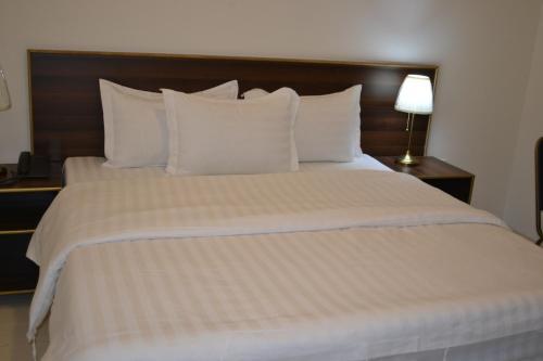 Cama ou camas em um quarto em Waqf Al Sherbiny 3