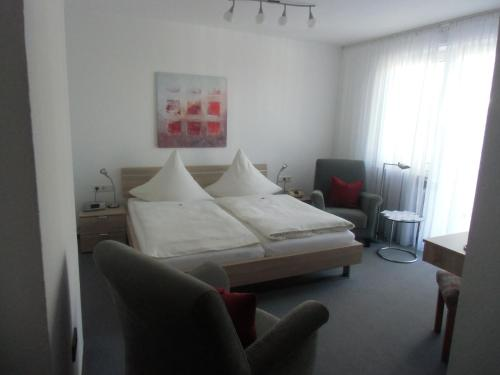 A bed or beds in a room at Haus Leifert