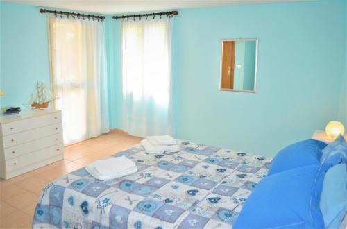 A bed or beds in a room at Casa Vacanze Mameli