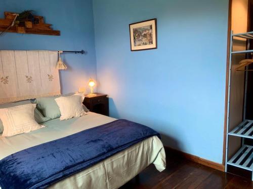 A bed or beds in a room at Posada de Ziga