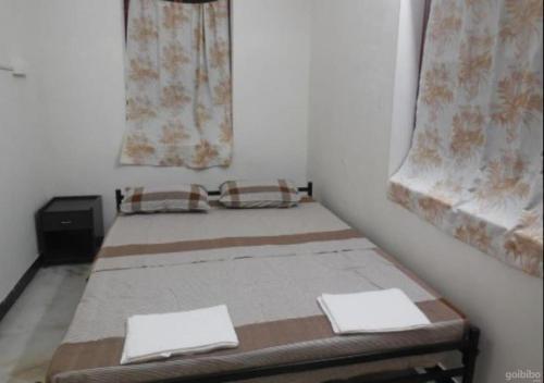 A bed or beds in a room at The Lost Hostel, Madurai