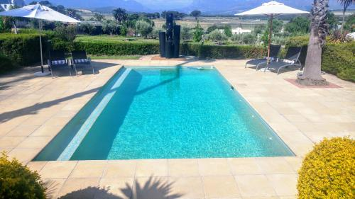 The swimming pool at or near Wild Mushroom Country House