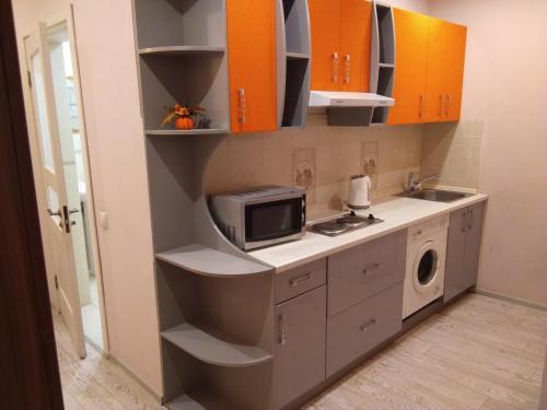 Кухня или мини-кухня в Отель Аквамарин
