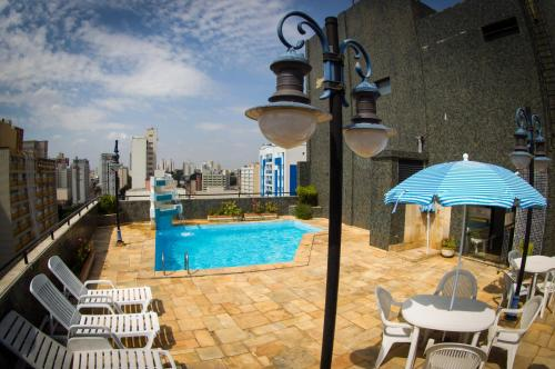 The swimming pool at or near LEON PARK HOTEL e CONVENÇÕES - Melhor Custo Benefício