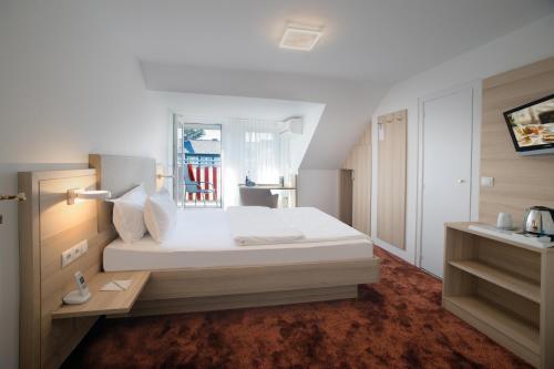 Een bed of bedden in een kamer bij Hotel Brenner