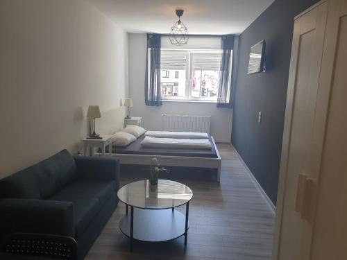 A seating area at Shiva's CityAparthotel