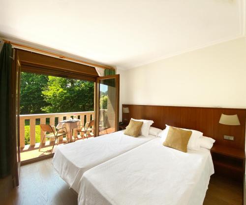 Cama o camas de una habitación en Hotel EntreRobles