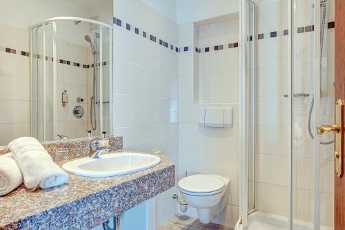 Ein Badezimmer in der Unterkunft Komforthotel Kaiserhof