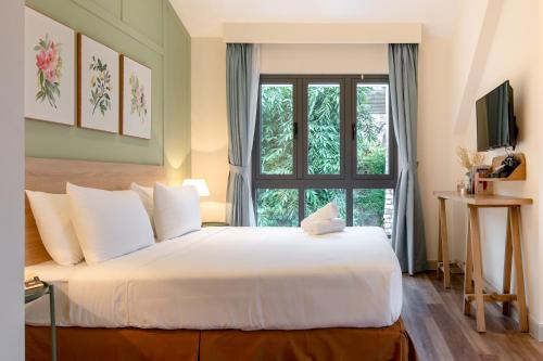 Giường trong phòng chung tại La Em Boutique Villa