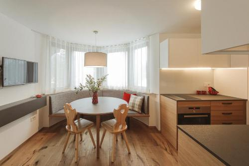 A kitchen or kitchenette at Apartments and Rooms Kaja