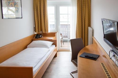 Ein Bett oder Betten in einem Zimmer der Unterkunft Salzburg Hotel Lilienhof