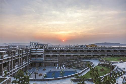 A view of the pool at Ramada Udaipur Resort & Spa or nearby