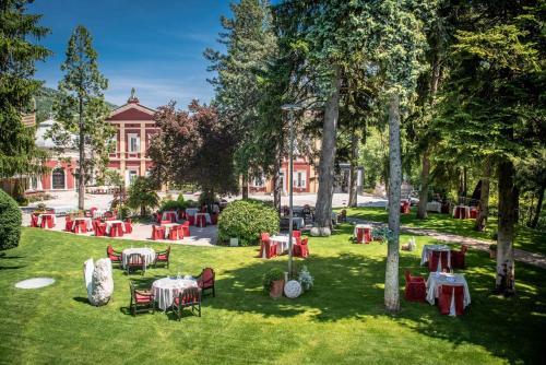 Ein Garten an der Unterkunft Hotel Villa Madruzzo
