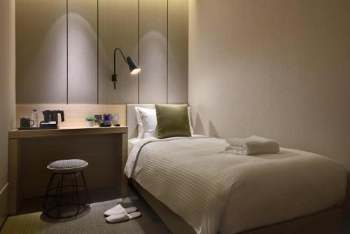 A bed or beds in a room at Aerotel Transit Hotel, Terminal 1