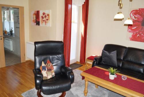 Ein Sitzbereich in der Unterkunft Ferienwohnung Am Sundern