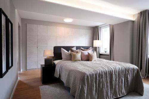"""Ein Bett oder Betten in einem Zimmer der Unterkunft SAXX Apartments """"Goldberg Karree"""""""