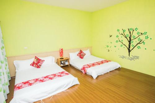 A bed or beds in a room at Gandan B&B