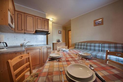 Kuchyň nebo kuchyňský kout v ubytování Appartamenti Bait Carosello