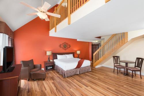 Un ou plusieurs lits dans un hébergement de l'établissement Ramada Plaza by Wyndham Gatineau/Manoir du Casino