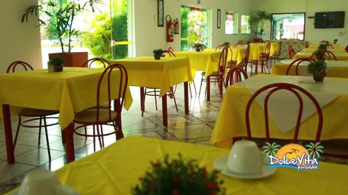 A restaurant or other place to eat at Pousada Dolce Vita