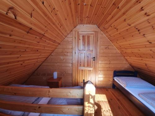 Łóżko lub łóżka w pokoju w obiekcie Anna i Halina