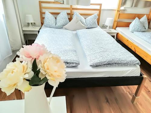 A bed or beds in a room at House L.A