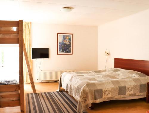 A bed or beds in a room at Børglum Mejeri