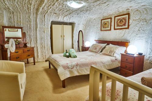 A bed or beds in a room at Underground Bed & Breakfast