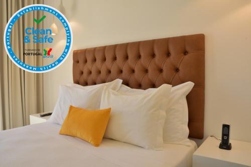 Uma cama ou camas num quarto em Hotel Sol Algarve by Kavia