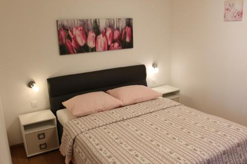 A bed or beds in a room at Apartments Kimm