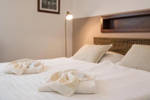 Posteľ alebo postele v izbe v ubytovaní Penzion Troja