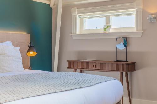Een bed of bedden in een kamer bij City Hotel Rembrandt