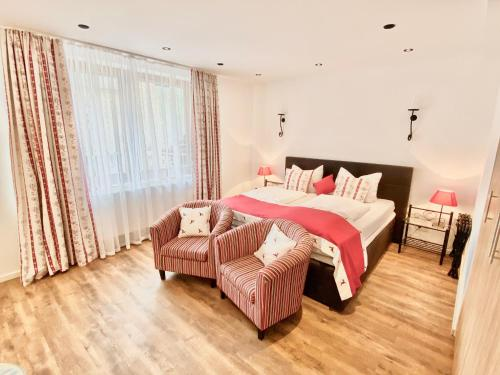 A bed or beds in a room at JUULS - Natur Hotel Garni