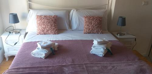 A bed or beds in a room at Residenza Solferino
