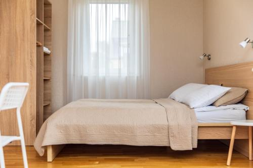A bed or beds in a room at Palangos Vila