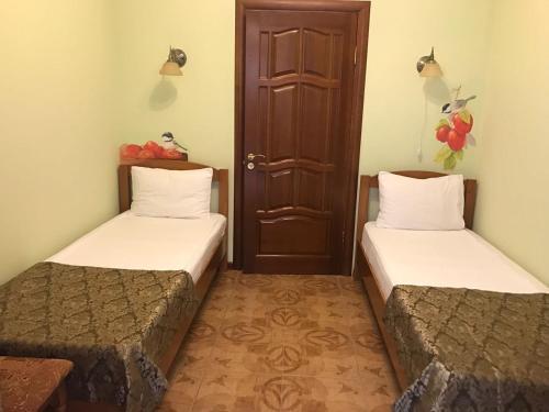 Кровать или кровати в номере Гостевой дом у Лукоморья