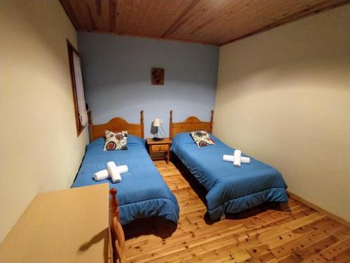 A bed or beds in a room at Hostal Pas De La Pera