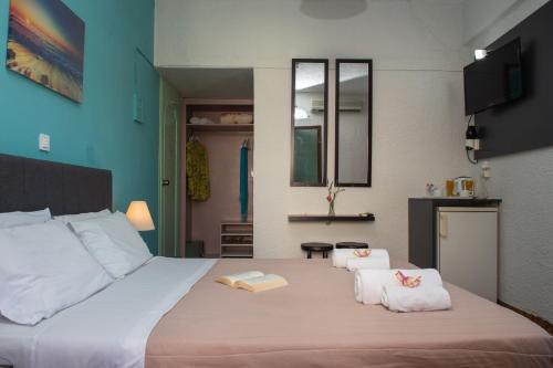 Ένα ή περισσότερα κρεβάτια σε δωμάτιο στο Ξενοδοχείο Αλκυών