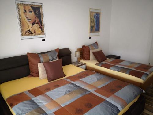 Ein Bett oder Betten in einem Zimmer der Unterkunft Villa Toscana