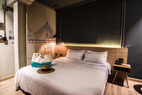 A bed or beds in a room at THA City Loft Hotel by TH District