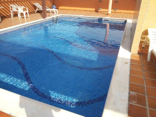 The swimming pool at or near Family & Bachelor Rooms