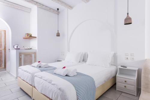 A bed or beds in a room at Cycladic Islands Hotel & Spa